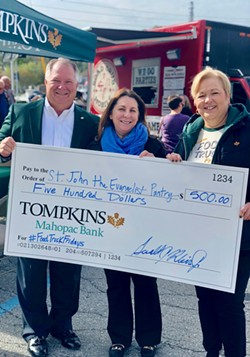 Enjoying a previous Tompkins Mahopac Bank Food Truck Friday event are. left to right, Gerald J. Klein, Jr., president and CEO, Tompkins Mahopac Bank; Nancy Gagne, director, St. John's Food Pantry; and Beth Lewis, vice president, branch manager of Tompkins Mahopac Bank's Mahopac branch. - Uploaded by Michelle Triunfo Obligado