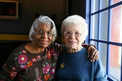 4f13472a_african_american_older_woman_and_white_older_woman_standing.jpg