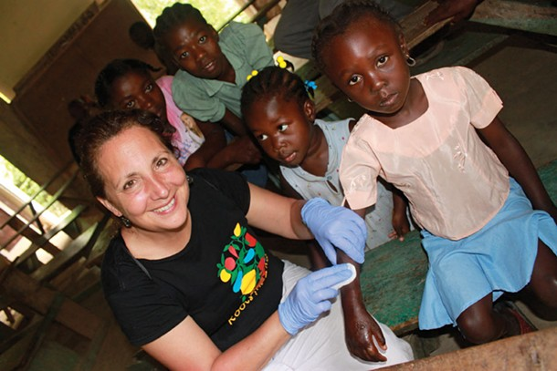 Vassar Haiti Project co-founder Lila Meade assists at the clinic in Fiervil, June 2011.