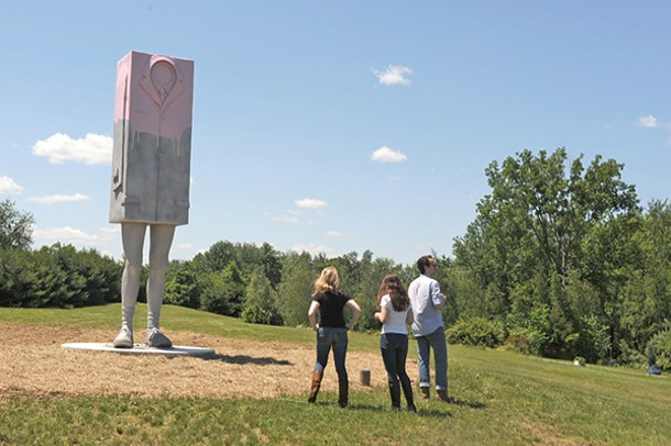 Visitors of Art Omi in Ghent stand in front of Erwin Wurm's Big Kastenmann during the Fields Sculpture Park opening on June 15.