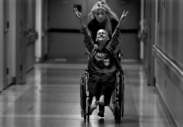 Waiting at Full Speed: Racing barefooted after kicking off her flip-flops, Cyndie French pushes her son Derek Madsen up and down hallways in the UC Davis Medical Center, distracting him before his bone marrow extraction on June 21, 2005.