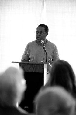 """Wesley Brown reads from his work at the """"River of Words"""" event. - JENNIFER MAY"""