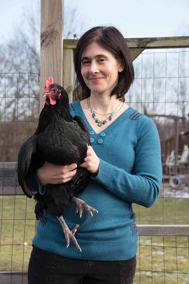 Winnie Abramson in the garden with her favorite chicken, Po. - PETER BARRETT