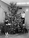 1955: Christmas decorations brighten up the Shaker Heights High School social room during the holiday season.
