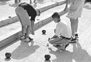 A bocce contestant keeps his eye on the pallino.