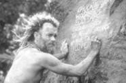 A bored Chuck partakes in some desert-island - graffiti.