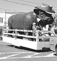A giant cow with a hat invades the Geauga County - Maple Festival (Thursday).