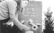 A mourner at the grave of a Black September victim.