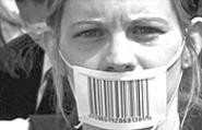 A protester, gagged and bar-coded.