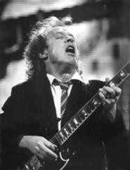 AC/DC's Angus Young sweats to the oldies at Gund - Arena. - WALTER  NOVAK