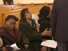 Antoinette Foster (left) sits next to Rosetta Smith at their brother's funeral.