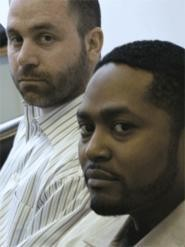 "Aric Jackson (foreground) with his lawyer, Ian Friedman, who says, ""It's disconcerting that men like these are wearing badges."" - KEVIN  HOFFMAN"