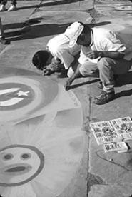 Artists craft their art at the Chalk Festival.