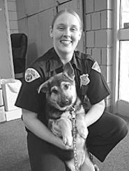 Awww. Jennifer Turner holds a rescued pup. - WALTER  NOVAK