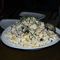 Crop Bistro & Bar: Ohio City Balsamic Popcorn ($6), Crop Bistro & Bar, Ohio CityA past time classic reinvented with some balsamic vinegar. The result is a decadent balance of flavor. Photo via Yelp