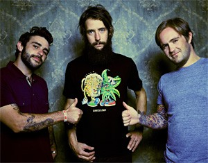 Ben Bridwell's bandmates give thumbs-up to his hippie-like head.