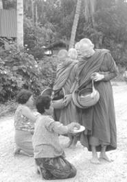 Buddhist monks receive alms.