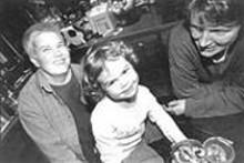 WALTER  NOVAK - Claire Zehnith plays with her two moms -- Keli Zehnder (left) and Deb Smith.