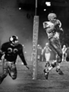 "Cleveland Browns vs. Pittsburgh Steelers- 1965  <p>Final Score- Cleveland 24: Steelers 19  <p>""Winning touchdown is scored by Gary Collins as he leaps into the air to take Frank Ryan's pass in the final 44 seconds of Saturday night's game against the Steelers. Bob Hohn, rookie defensive back, looks on. This last-minute touchdown put the Browns ahead 24-19, giving the Browns a 3-1 record for the 1965 season."""