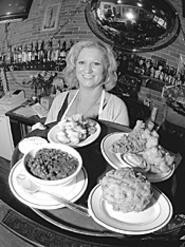 "Clockwise from right rear: Catfish platter, fried - macaroni and cheese, red beans and rice, fried - pickles, and Susie ""Slingo"" Porter, home-cookin' - mama. - WALTER  NOVAK"