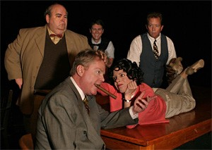 Comedy Central: John J. Polk (bottom left), Rachel Spence, and company.