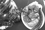 Comfort food, Russki-style: Cabbage rolls, stuffed - pepper, pelmeni, and sausage. - WALTER  NOVAK