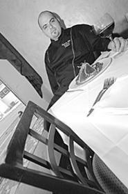Doing things his way: Chef Atheneos and his seared - ahi tuna. - WALTER  NOVAK