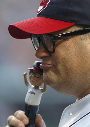 Drew Carey asks a blackjack dealer if he can use his bobblehead to double down. - ASSOCIATED PRESS