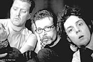 "Eagles of Death Metal frontman Jesse Hughes - (center) strives to be ""the white Morris Day of rock and - roll."""