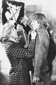 Easy on the Jam: Mom (Lin Shaye) dispenses some discipline on her son (Sam Huntington).