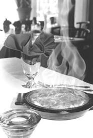 Flaming saganaki kindles appetites at the Greek Isles. - WALTER  NOVAK
