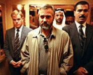 George Clooney (center) plays a failed CIA assassin surrounded by corruption.