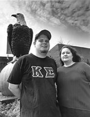 Hawks and eagles: Ashbrook scholars Dan Tierney - and Beth Vanderkooi, with campus mascot Old Abe. - WALTER  NOVAK