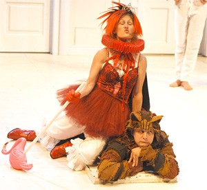 Heather Lea Anderson Boll's Queen of Hearts silences Nick Koesters' Cheshire Cat.