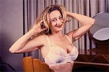 Help this lady get bigger boobs this holiday season.