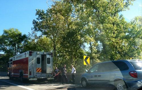 Investigators gather along the I-90 ramp to the Inner Belt, just outside the crime scene