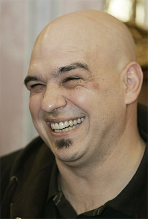 Iron Chef Michael Symon's photogenic smile shone positive light on C-Town's food scene. - AP PHOTO/TONY DEJAK