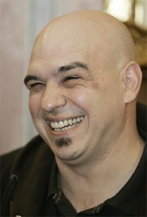 Iron Chef Michael Symon's photogenic smile shone positive light on C-Town's food scene. - AP PHOTO/TONY DEJAK
