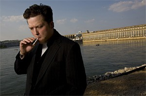 Jason Isbell contemplates the serene shoreline with a healthy drag of a cigarette.