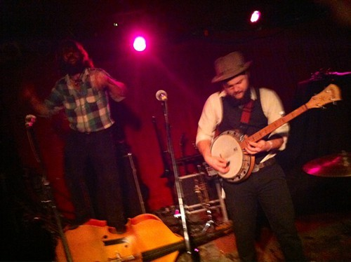 Jeshua Marshall stands on his bass, while Andrew Carew shreds the banjo.