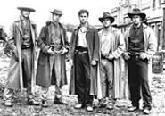 Jesse (center) and his gang of impeccably manicured outlaws.