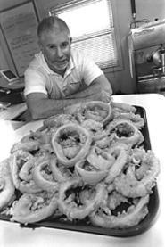 Joe Orange, with a large order of Bearden's wonderful beer-battered onion - rings. - WALTER  NOVAK