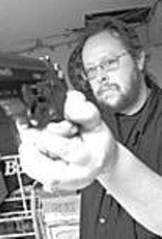 John Sahady's basement shooting range keeps him      going between club meetings.