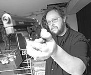 John Sahady's basement shooting range keeps him - going between club meetings. - WALTER  NOVAK