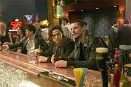 Joseph Gordon-Levitt and Matthew Goode busily plotting bank heists over a beer or two.