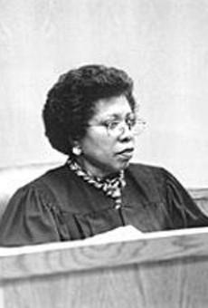 Judge Janet Burney sentenced Scruggs to six years.