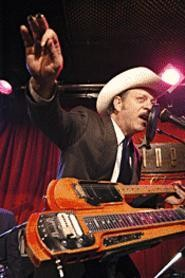 Junior Brown makes guitar-player faces onstage.