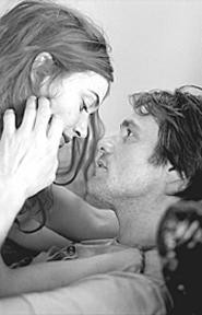 Kate Winslet and Jim Carrey hold on tight as they - spiral into oblivion.