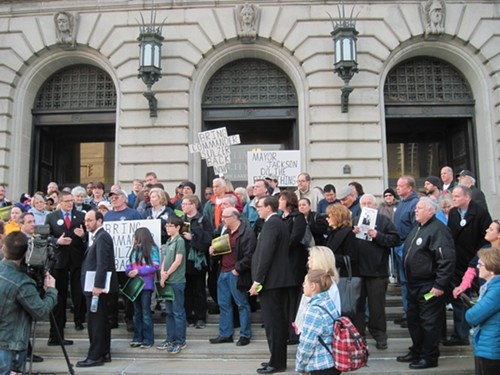 Keith Sulzer supporters gather outside City Hall on March 31.