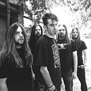 Lamb of God frontman Randy Blythe (center) wants - you to drink lots of water before seeing his band play.